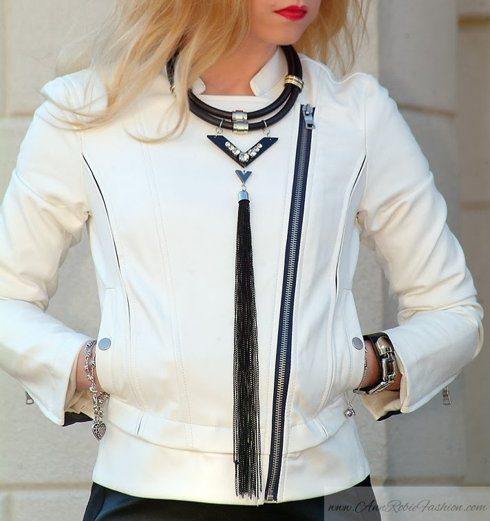 a white Leather Jacket with a black mini dress by petite style blogger AnnRobieFashion
