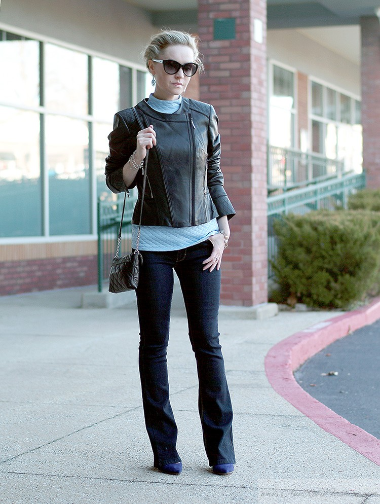 Ann Robie Fashion style: how to wear blue quilted top with jeans and black leather jacket, sky blue earrings