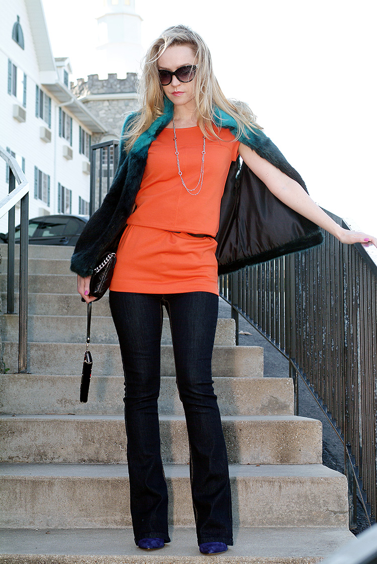 Bright colors: Orange Top Jeans and navy blue and turquoise vest