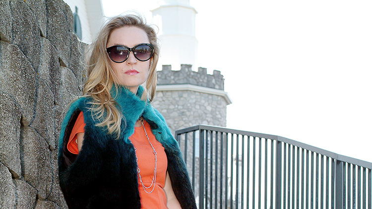 AnnRobieFashion style: Orange top jeans and navy blue and turquoise vest