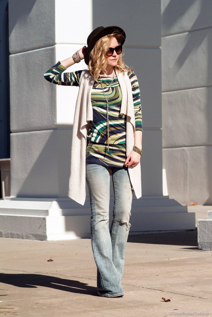 How to wear a sleeveless cardigan: Sleeveless tan cardigan Ann Taylor, green multi color dress, flared jeans Ralph Lauren, olive green-hat Target - outfit by petite style blogger AnnRobieFashion
