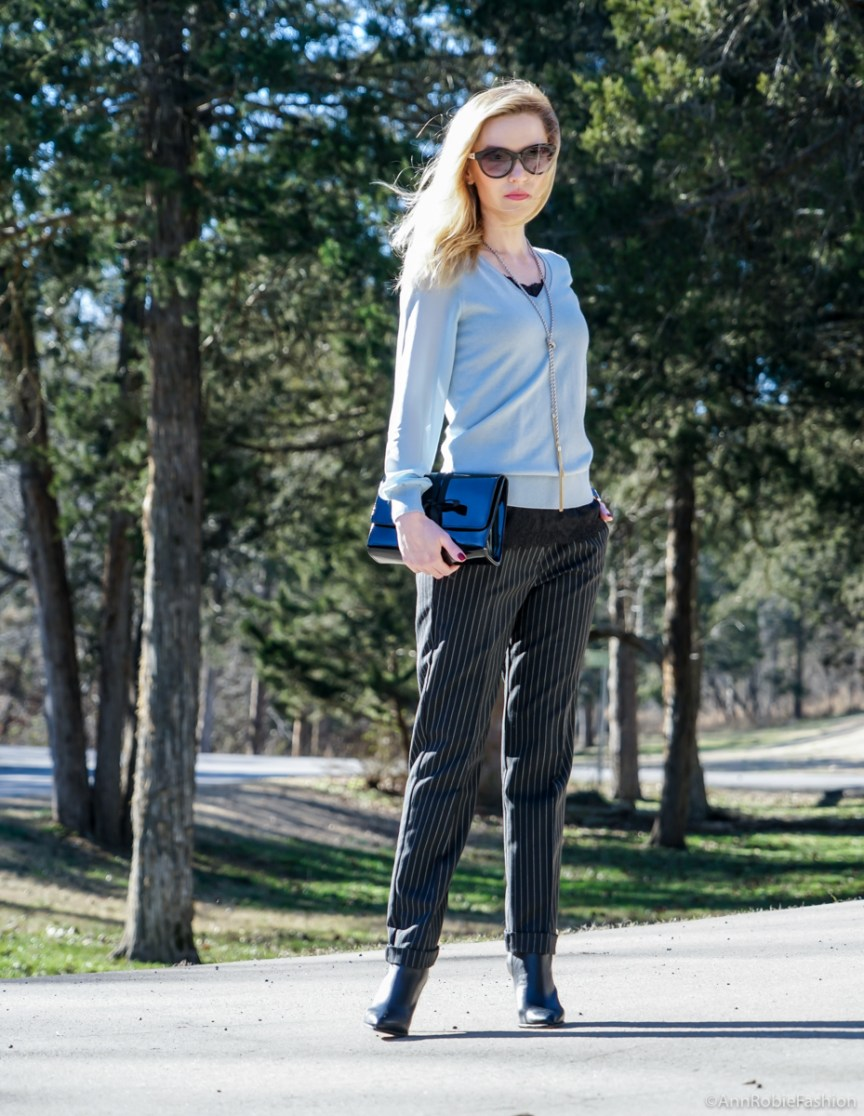 Winter street style: Blue sweater with the sheer sleeves Ann Taylor, striped pants Asos, leather ankle booties Vince Camuto - outfit by petite style blogger AnnRobieFashion