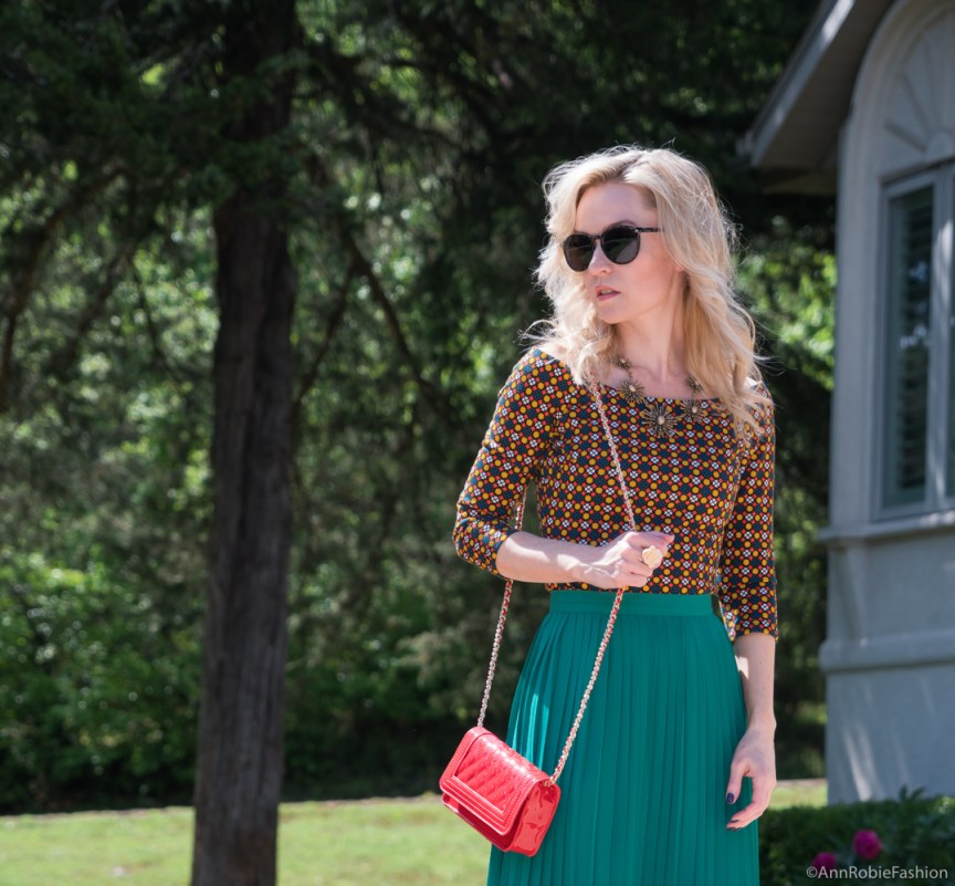 Green and Red: Green midi pleated skirt, off-shoulder top, red cross-body bag - summer outfit by petite style blogger AnnRobieFashion