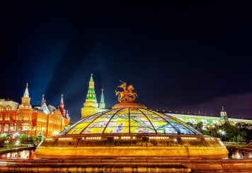 The vibrant colors of major Moscow landmarks, close to Red Square, by night.