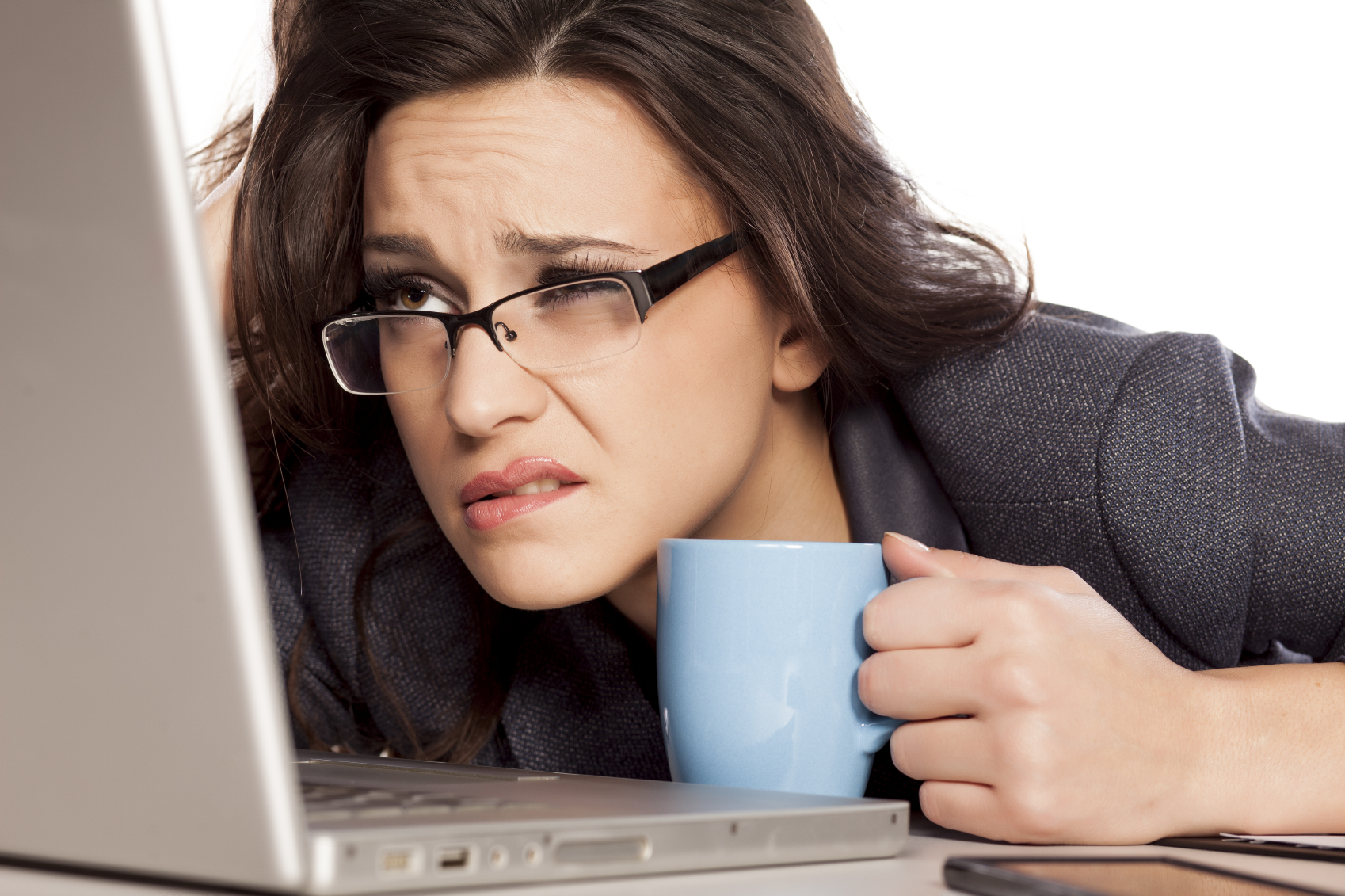 woman squinting at screen