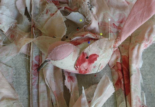 pale pink songbird