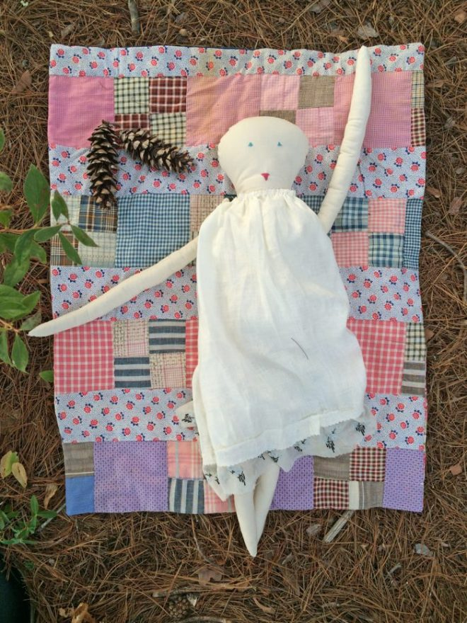 rag doll and quilt