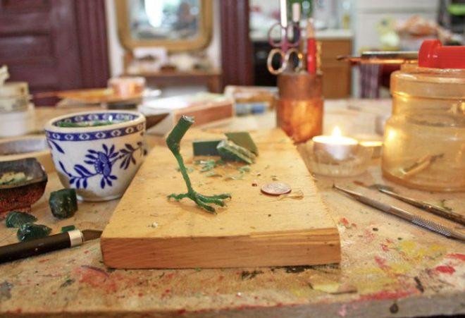 carving a wax bird foot