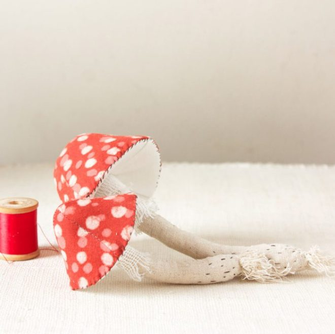 two handmade toadstool with red caps