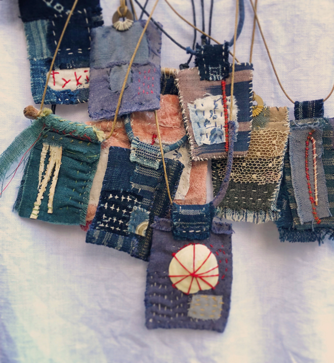 amulets stitched from antique textiles