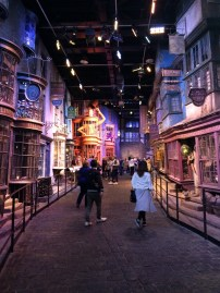 A view down Diagon Alley. Classic shops featured, like Ollivander's and Flourish & Blotts, as well as Weasleys' Wizard Wheezes from later in the series.