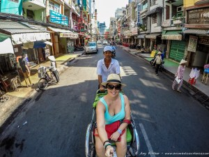 Travelling in style in HCMC on a xe om.