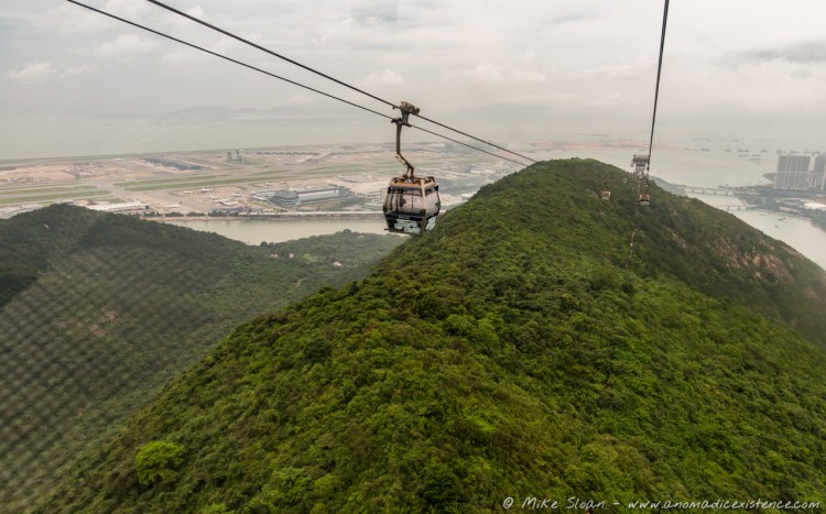 Taken inside the gondola - the views from the cable car approaching Tung Chung - Hong Kong Airport is seen to the left!