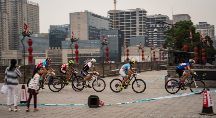 Captured mid-race along the ancient city walls!