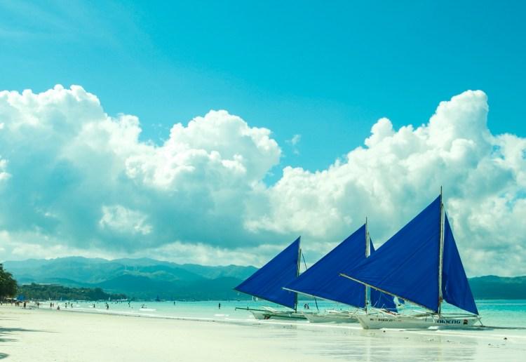 Sailboats moared on White Beach in Boracay.