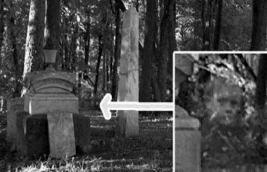 Old ghost photo of a young boy in a cemetery