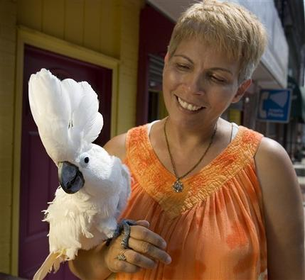 """Evelyn DeLeon holds her umbrella cockatoo Luna in Trenton, N.J.,Thursday, Sept. 4. 2008. A persistent cry of """"Help me! Help me!"""" coming from DeLeon's Trenton house turned out to be from the bird. Neighbors called police, who knocked in the door. Inside, they found the cockatoo with a convincing call.(AP Photo/ Michael Mancuso/Trenton Times )"""