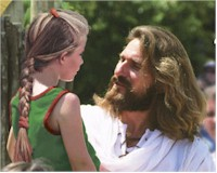 This is Jesus, with his fabulous, non blood matted hair, talking with an innocent child just minutes before the beginning of the end.