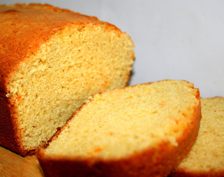 Orange Tea Cake, sliced, and ready to be served with our favorite Castleton First Flush Tea.