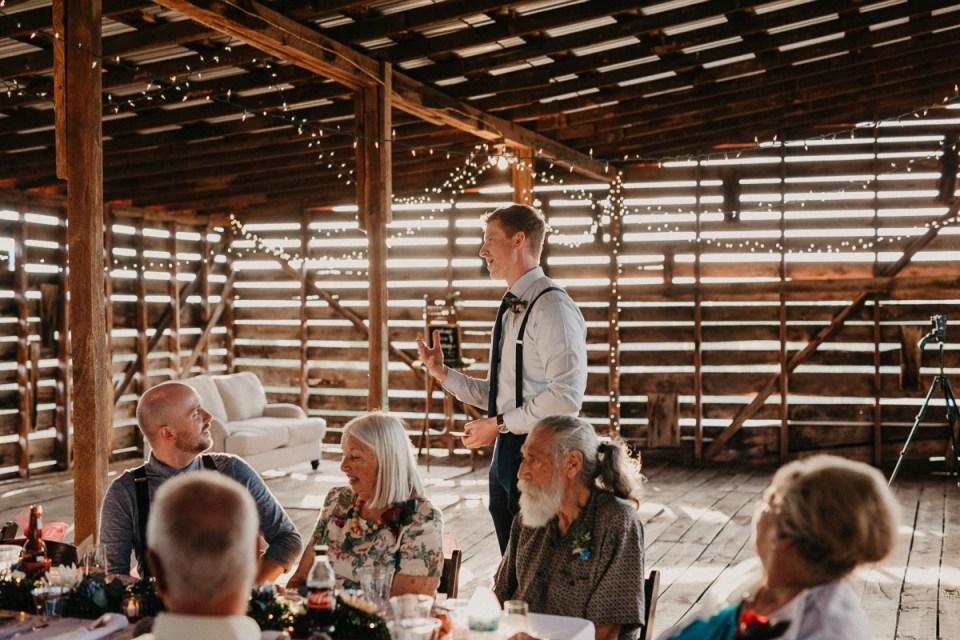 Groomsmen giving his speech for an Asheville elopement.