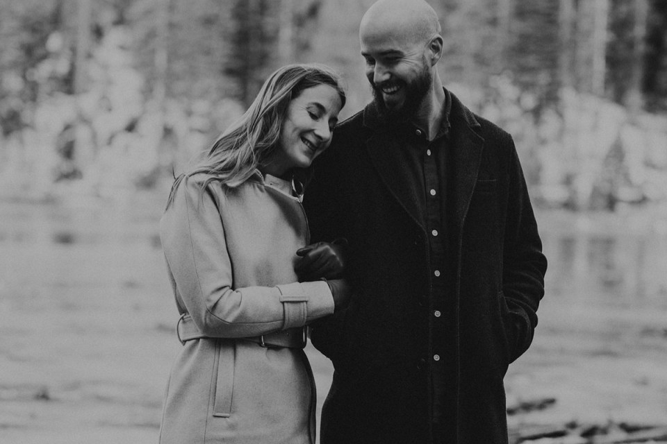 Couple laughing during their Rocky Mountain National Park engagement photos.
