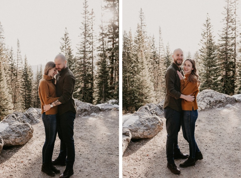 Couple smiling and looking at camera during their Rocky Mountain National Park engagement photos.