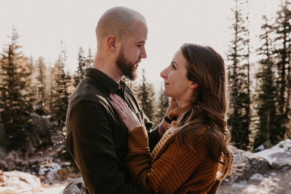 Couple lovingly staring in each other's eyes during their Rocky Mountain National Park engagement photos.
