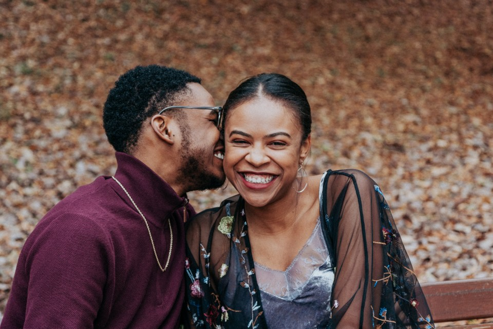 Couple laughing together after getting engaged.