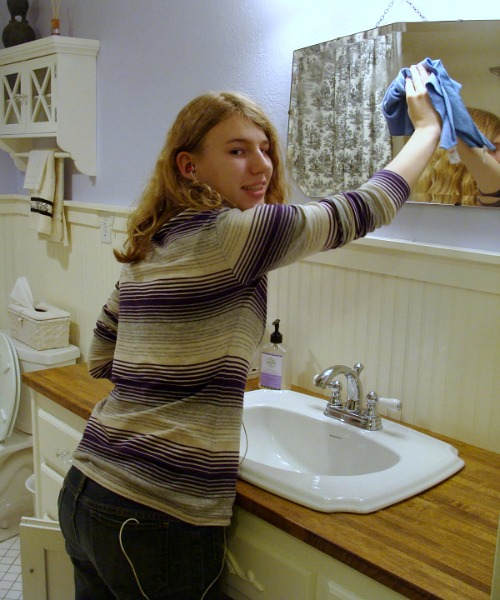 Cleaning bathrooms on family cleaning night