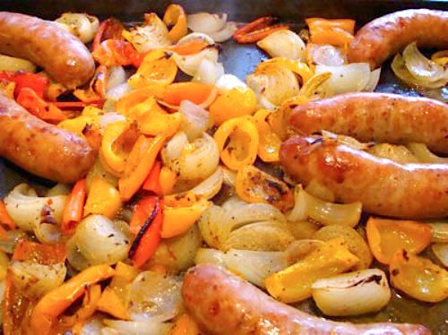 Sheet pan dinner easy roasted sausages, peppers and onions.