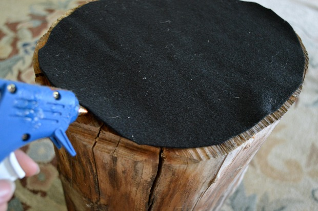 Hot glue felt to bottom of a wood stump to make an easy DIY side table! An Oregon Cottage