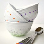 Fun, colorful, painted bowl and spoon sets that are dishwasher safe using gloss enamel craft paint & paint pens.