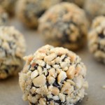 Make these easy peanut butter chocolate truffles with just five simple ingredients: chocolate chips, peanut butter, cream, butter and chopped nuts. They take just a few minutes and taste amazing!