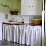 Cottage Farmhouse Laundry-Mudroom Makeover after-laundry area with sink, washer-dryer and drying closet.