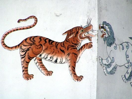 Tiger and Snow Lion on the wall of a house in Phuentsholing, Bhutan