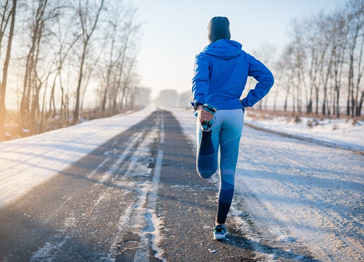 woman-stretching-before-running-in-the-snow.jpg