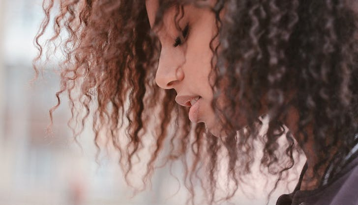 young_woman_with_curly_hair.jpg