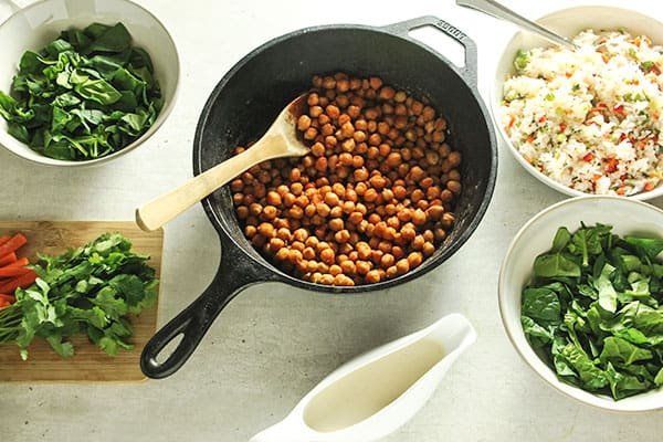 ingredients for buffalo chickpea bowls on white board
