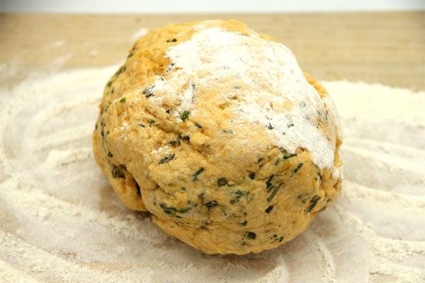 vegan sweet potato biscuit dough on floured board