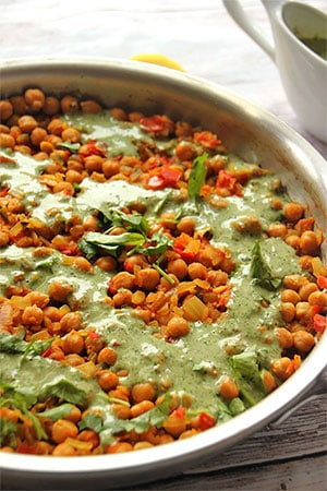 Chana masala with chickpeas topped with coriander coconut cream.
