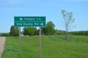 Turn left for Happy Lane, turn right for Old Dump Road.