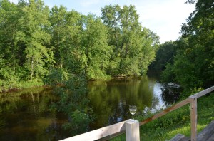 """My view of the Oconto River this weekend, a mellow and thought provoking place to enjoy """"In the Shadow of the Bayon,"""" whose river, the Mekong, is a more powerful and violent character."""