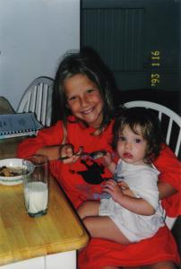 Molly has enjoyed the cheerful support of her three siblings since the day she was born. This is her sister Katherine.