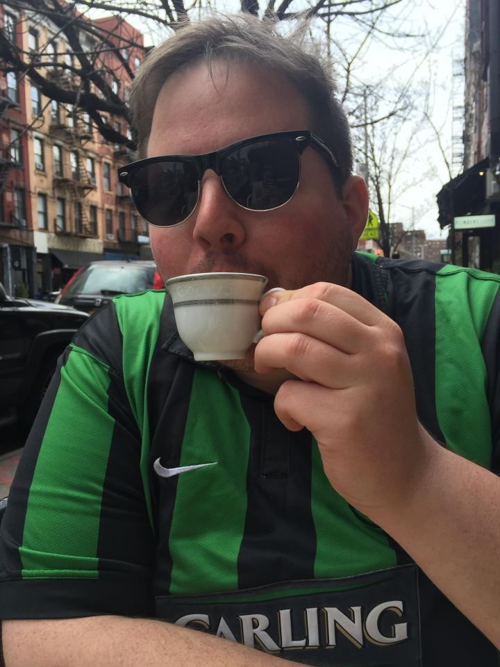 Charlie sipping tea in New York