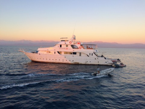 Another dive boat lit up by the colorful sunset