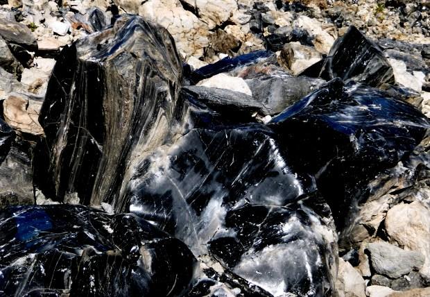 Chunks of obsidian (black volcanic glass), Big Obsidian Flow, Newberry National Volcanic Monument, Oregon