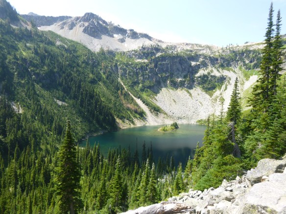 Passing Lake Ann on Maple Pass Trail above dense forest line, North Cascades National Park, WA