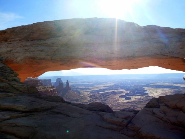 View through Mesa Arch to canyon below, Mesa Arch Trail, Canyonlands National Park, Utah