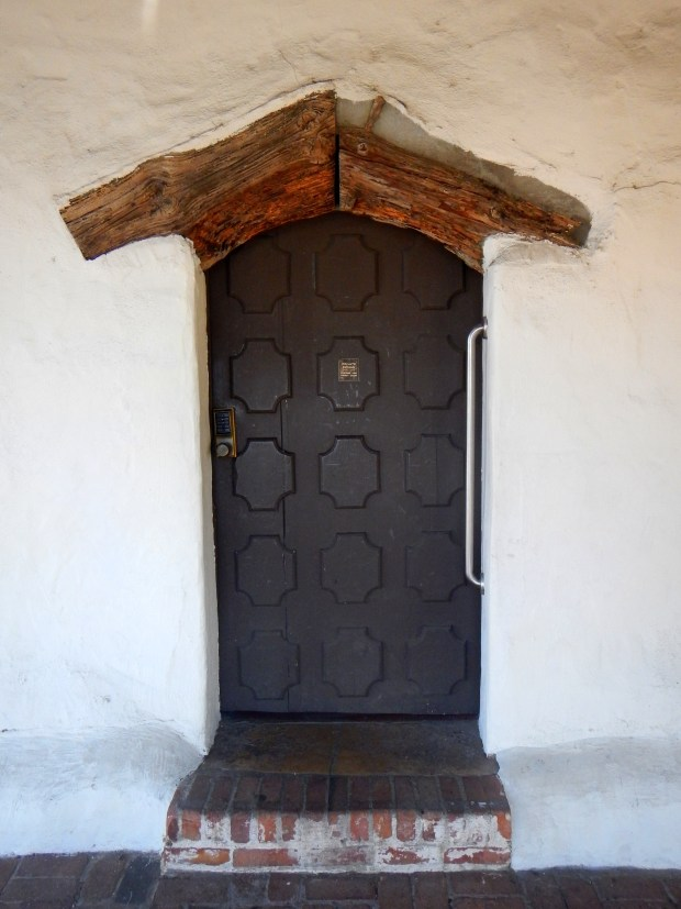 Door in quadrangle with juniper lintel, Mission San Luis Obispo, California