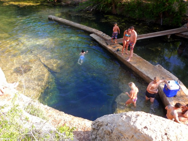 Looking down into Jacobs Well from cliffs, Texas